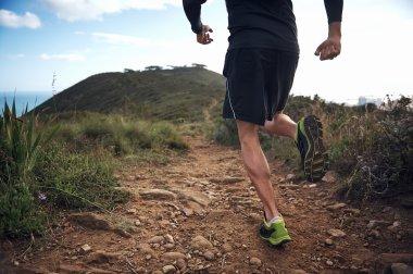 Trail running athlete exercising for fitness