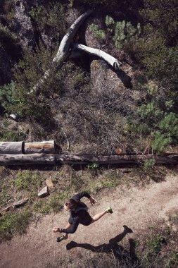 trail runner running on mountain