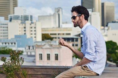 Man outdoors smoking cigarette