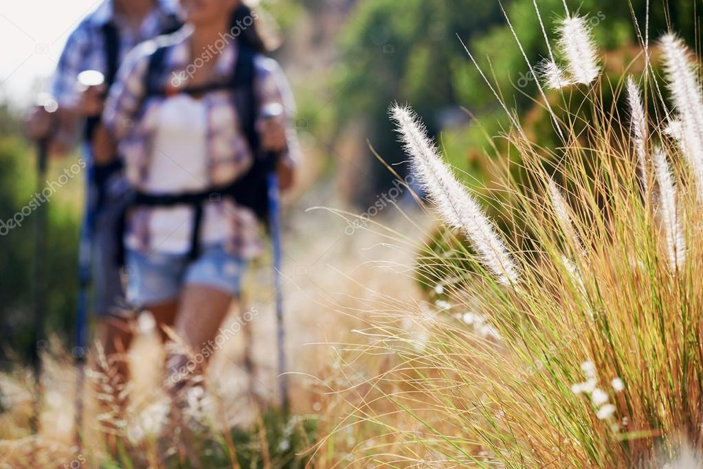 couple walking along hiking trail