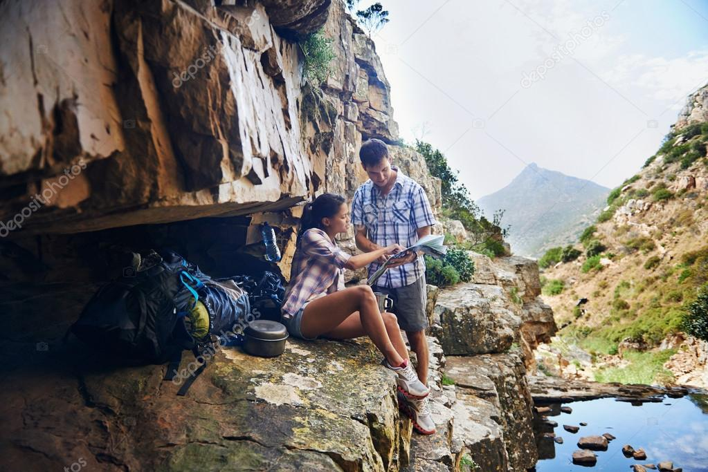 couple taking break from hiking trail