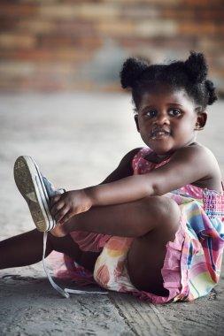 african girl tying shoelace