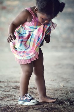 African poverty toddler with one shoe