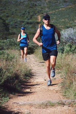 couple trail running together for sport
