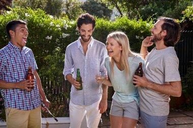 Friends having outdoor garden party