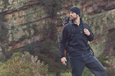 man hiking wilderness mountain