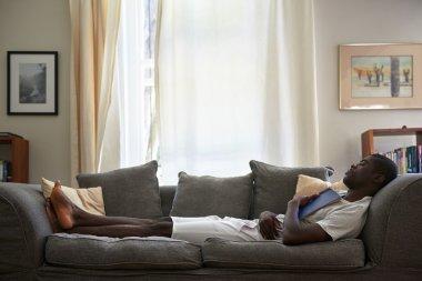 Man book sofa couch sleeping