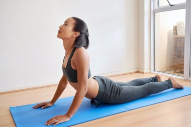 Woman practicing indoor yoga