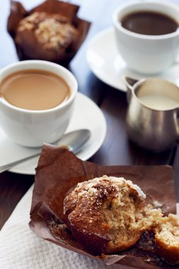 cups of coffee and muffins on it
