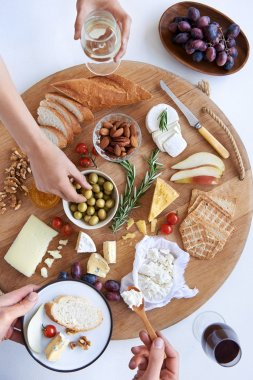 Cheese board with hands, party snacks