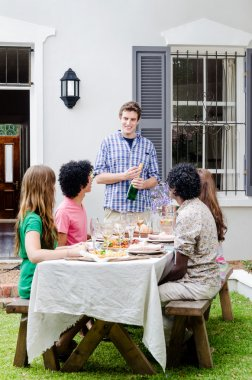 Outdoor entertaining with champagne and food