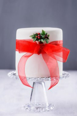 Christmas cake with red ribbon and mistletoe