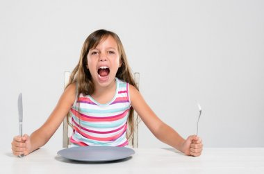 Rude screaming child at dinner
