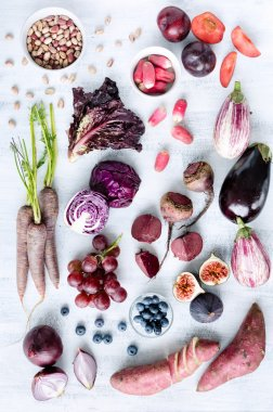 Assorted purple toned fruits and vegetables