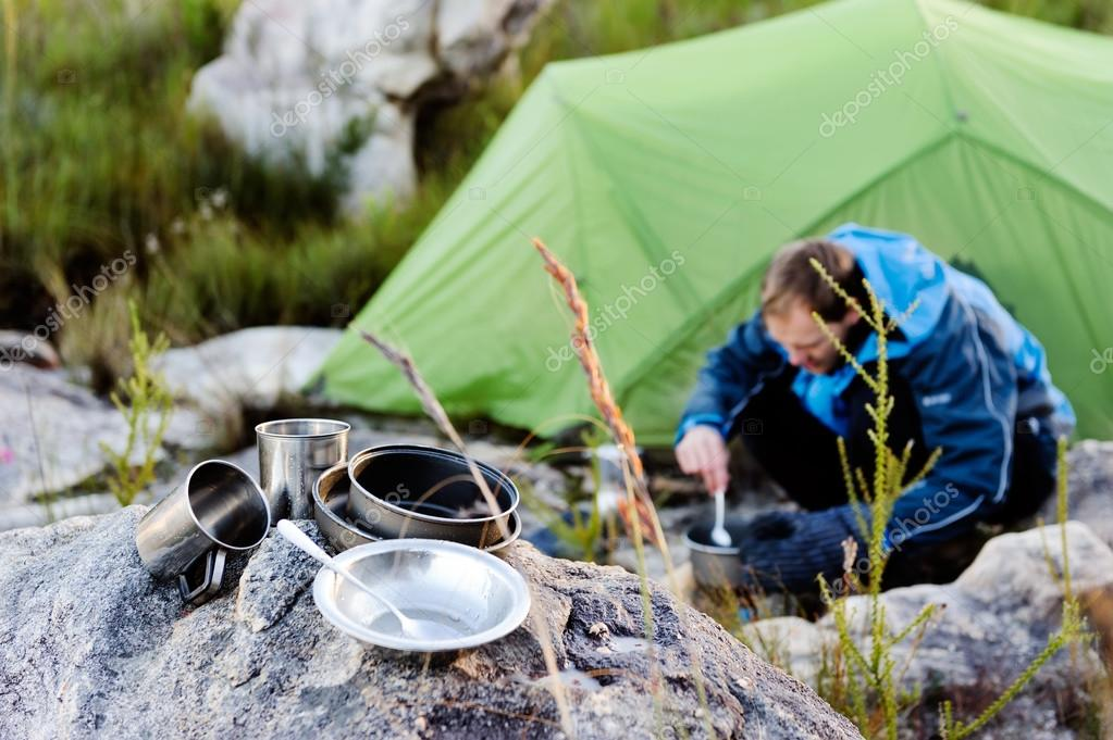 Outdoors man cooking