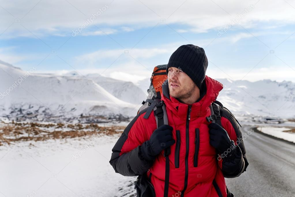Hitchhiking backpacker in iceland