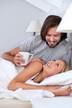 Husband brings wife coffee