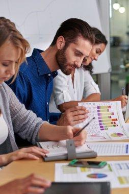 businessman checking company charts