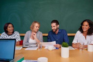coworkers meeting in boardroom