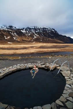 Tourist traveller man soaking in Iceland