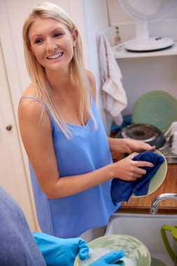 woman in the kitchen doing household chores
