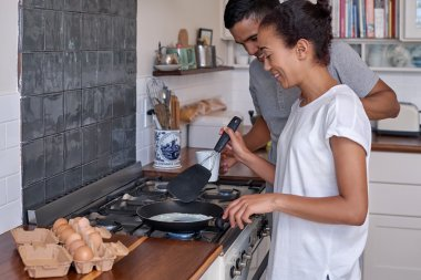 couple making breakfast together