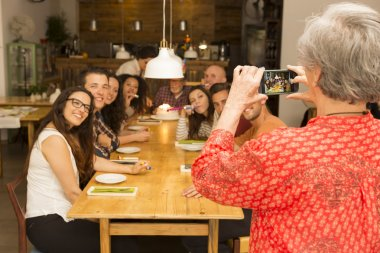 Granny taking a picture of all family