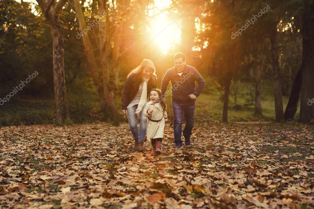 Happy family enjoying the fall season