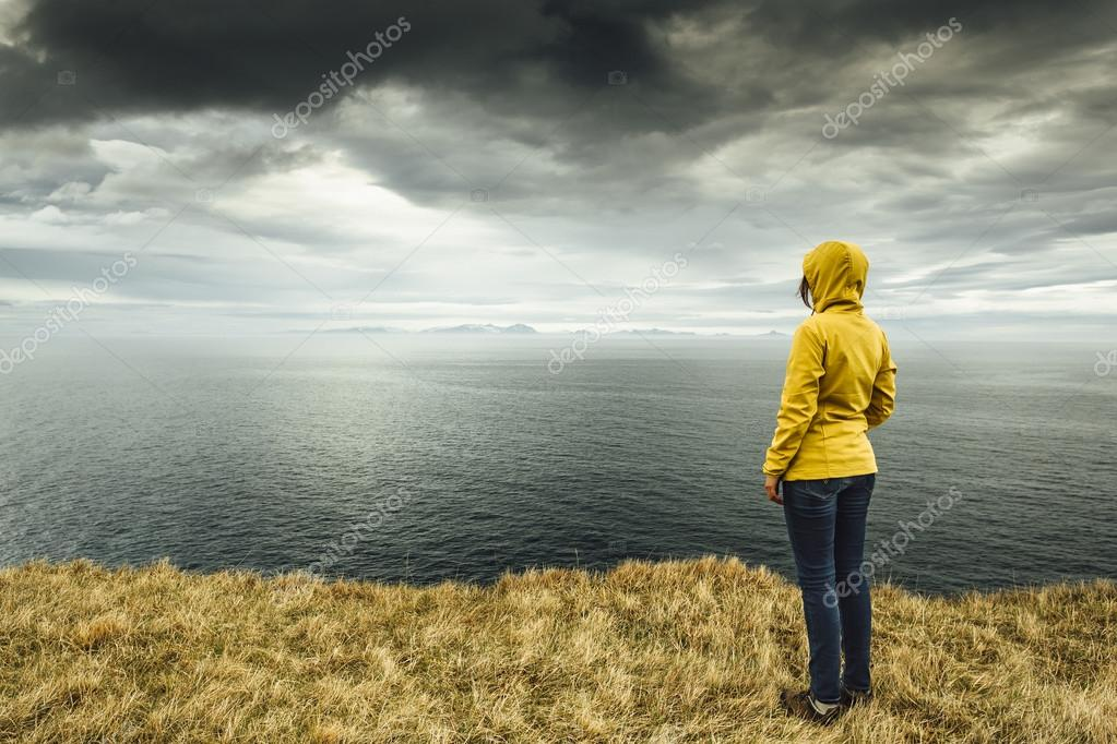Woman contemplating a beautiful landscape