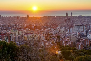 The sun rises over Barcelona