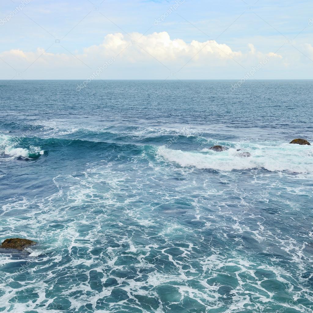 Beautiful ocean waves and blue sky