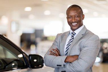 car dealership principal in vehicle showroom