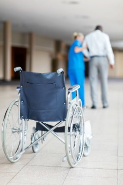 nurse helping patient to walk
