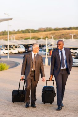 Businessmen walking in airport
