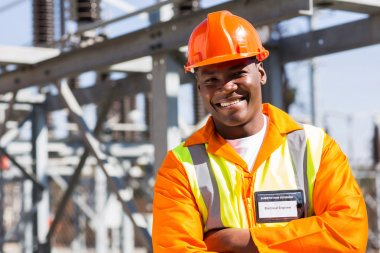 African engineer with arms crossed