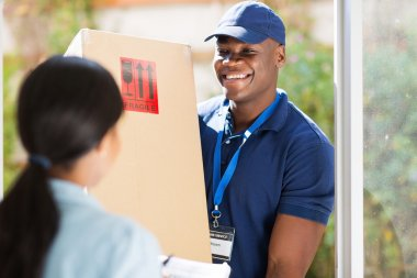 African-american delivery man with package