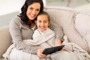 Woman and her daughter on couch