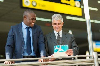 Businessmen holding air ticket
