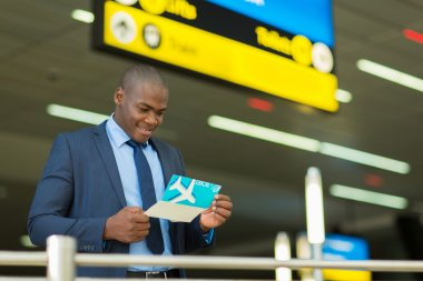 African-american businessman checking his ticket