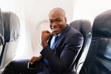 African-american businessman on airplane