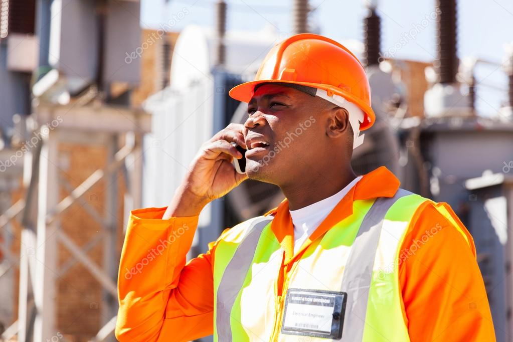 Engineer using cell phone