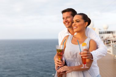 Couple on cruise holding cocktails