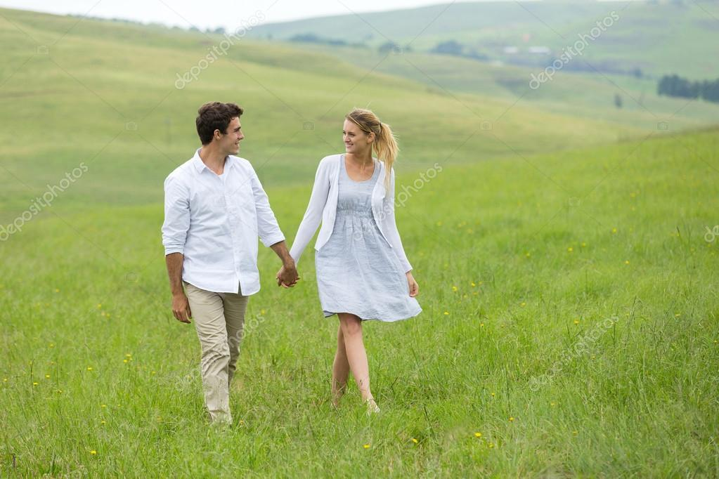 couple walking on countryside
