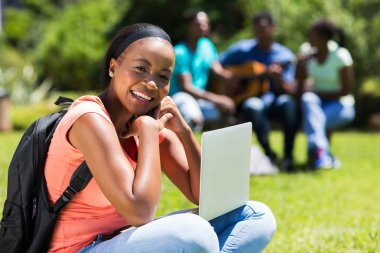 young black college student with laptop