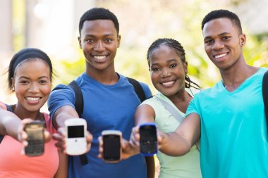 College students showing smart phone