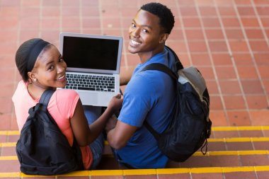 Young college couple with laptop computer