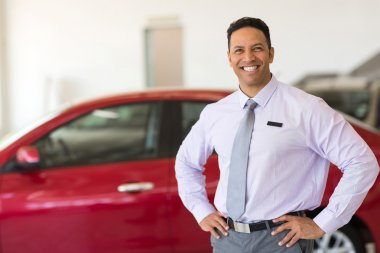 middle aged vehicle sales consultant