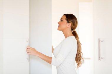 Woman opening wardrobe