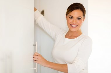 woman opening closet door