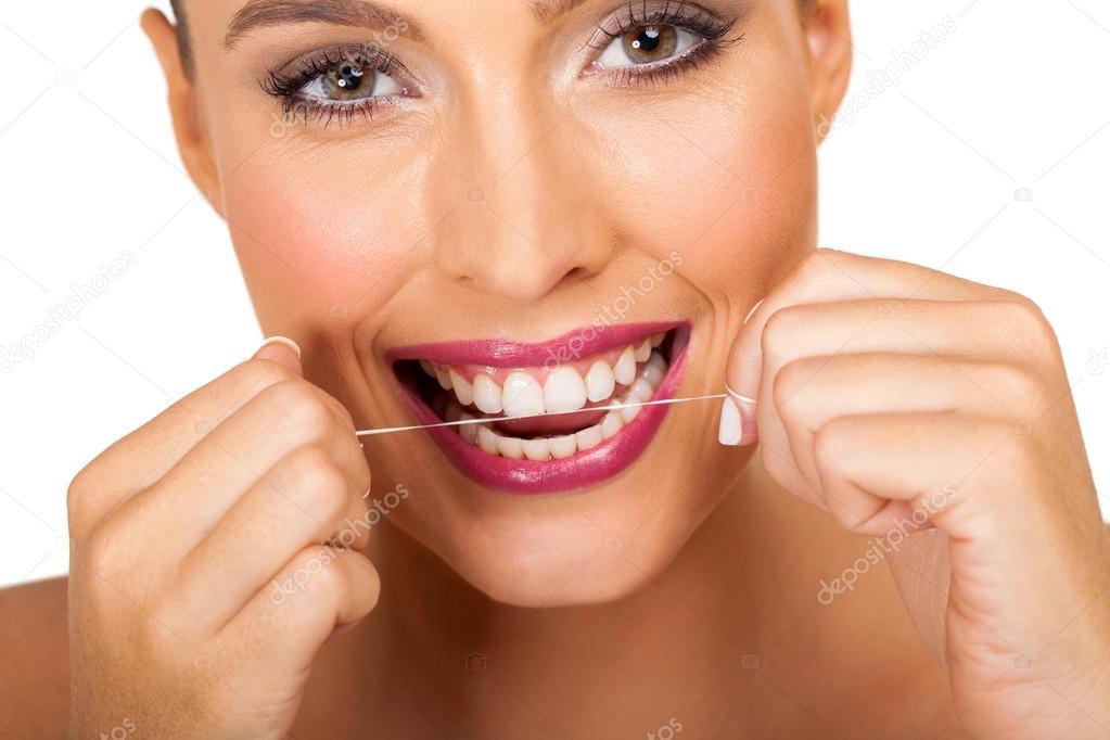 d4ff5bd74 mulher usando fio dental — Stock Photo © michaeljung  74607823